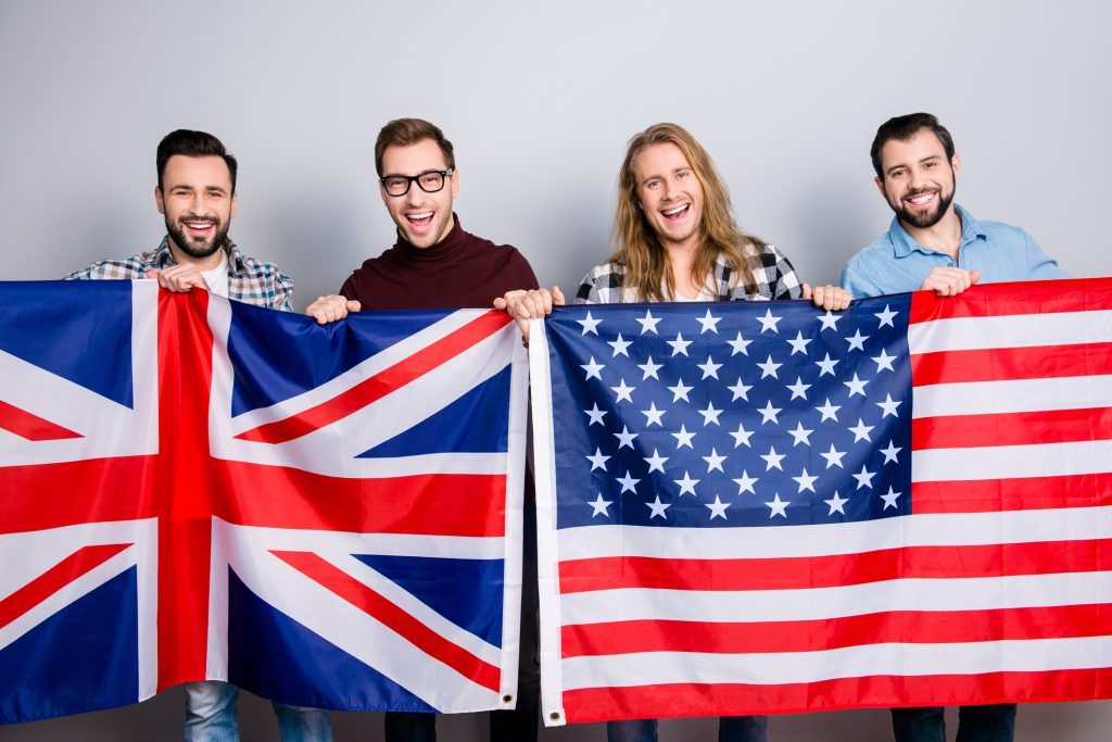the differences between american english and british english friends holding flags