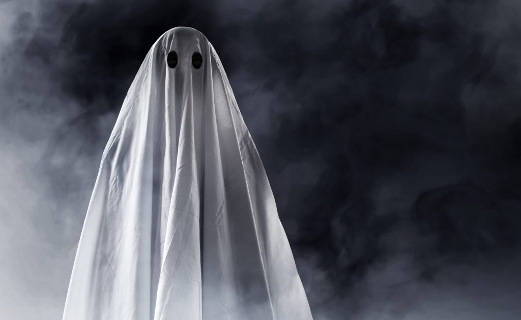 halloween fancy dress costumes as a ghost with a sheet over head