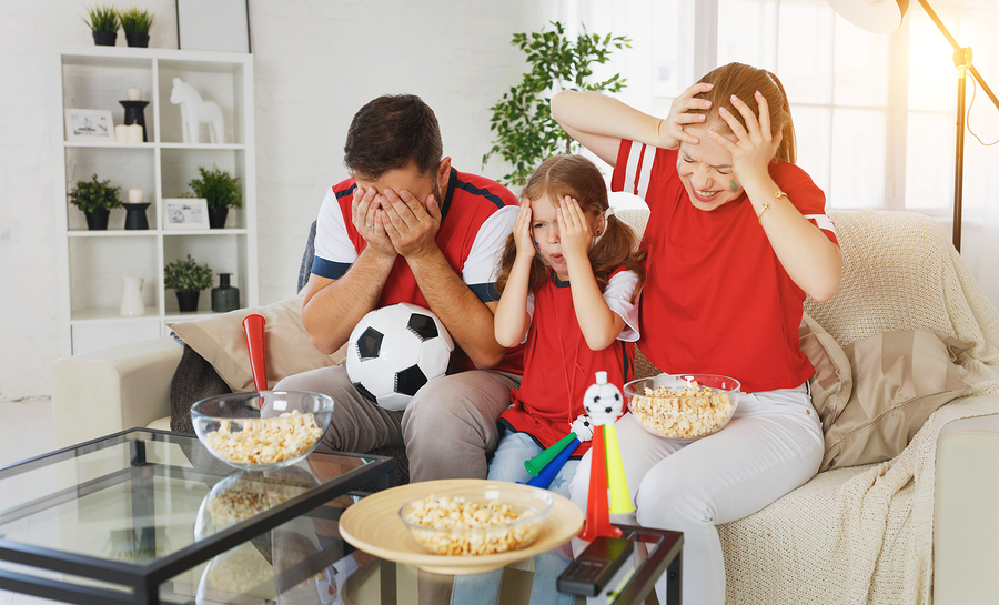French family watching the football