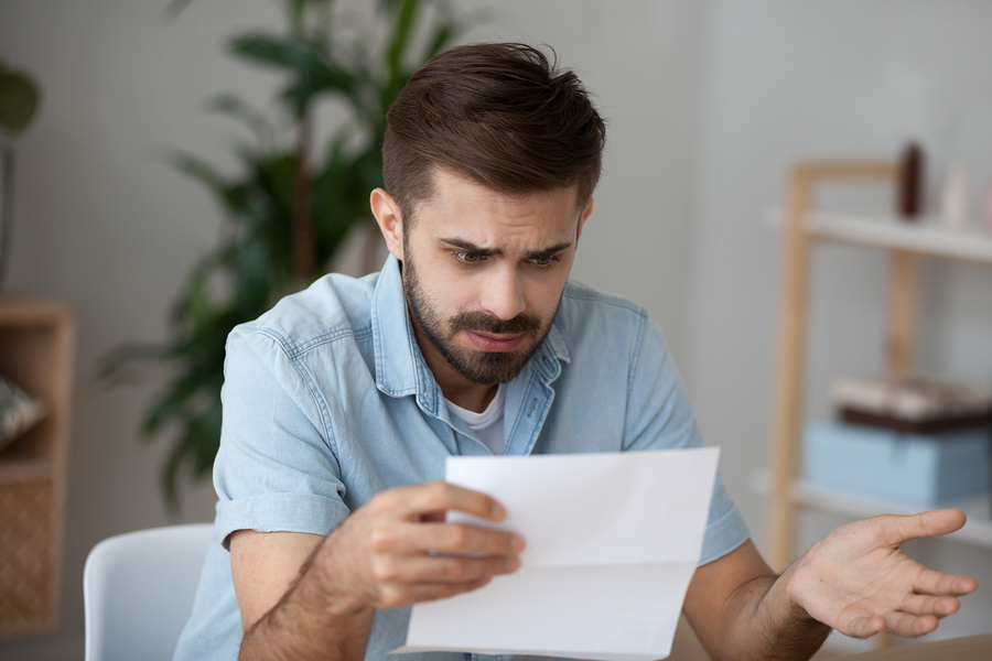 man confused by German letter with lots of abbreviations